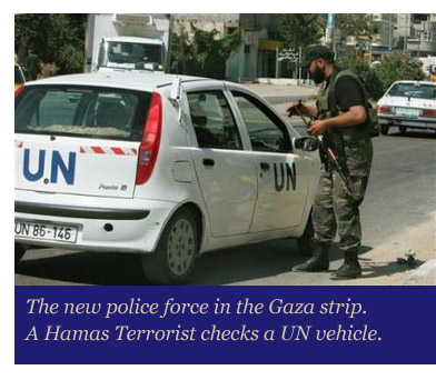A Hamas Terrorist checks a UN vehicle.